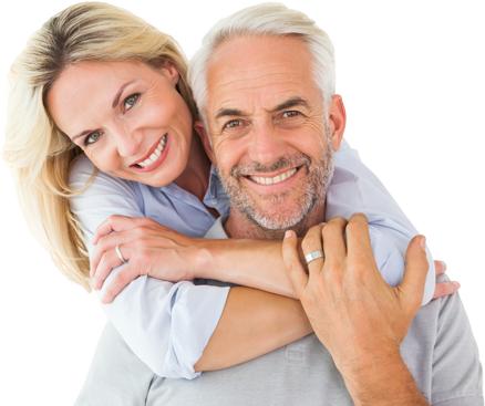Older couple hugging and smiling happily