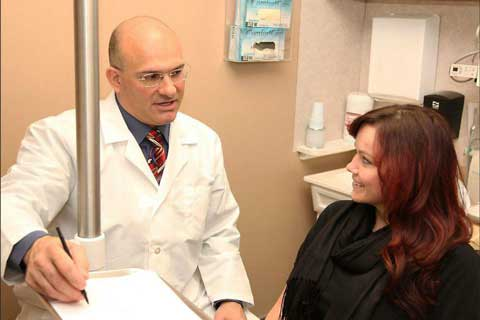 Dr Sal with a patient